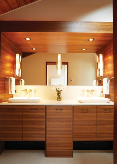 A double-basin vanity made of linear-grained walnut adds warmth and modern style.