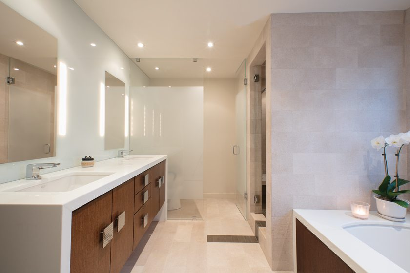 Andreas Charalambous designed the luxurious master bath with a Kohler vanity, whirlpool tub and large shower.