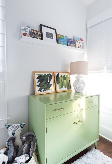 A vintage chest adds a pop of  color in Cannon's room.