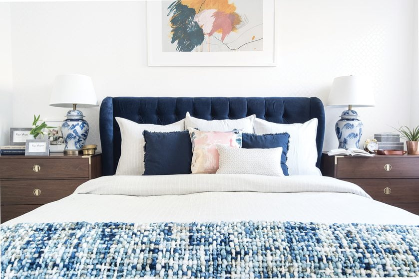 An abstract by Heather Day floats above a velvet headboard in the master bedroom.