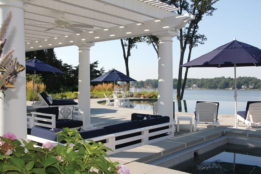 The pergola offers shade beside a vanishing-edge pool overlooking the Severn River.