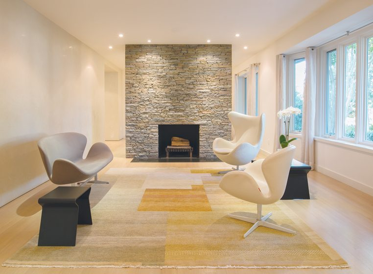 A stone fireplace wall divided the living and dining rooms.