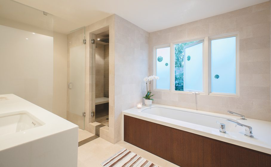 Limestone tile from Stone Source covers the floors while the countertops are white Thassos marble.
