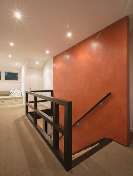 Venetian plaster on the staircase wall adds color and texture to the upper hall.