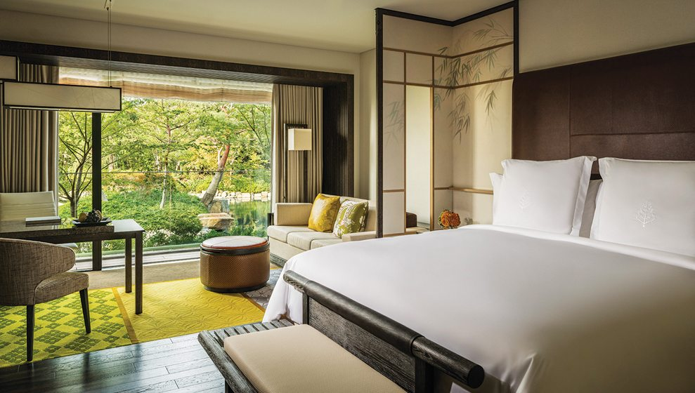 Guest rooms feature shoji panels and rich polished woods.