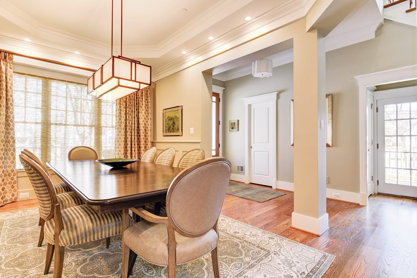 A tray ceiling details the dining room in a custom home by Mid-Atlantic Custom Builders. © BTW Images