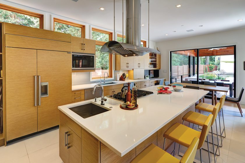 Studio Z Design Concepts, LLC, completed a custom home with a clean-lined kitchen. © Stu Estler Photography