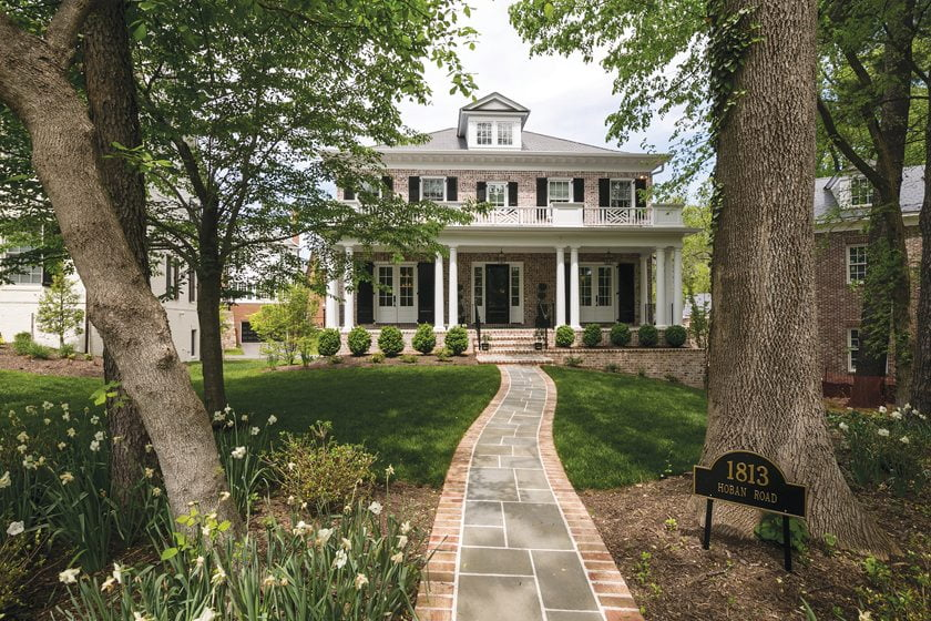 Sandy Spring Builders, LLC, crafted a custom traditional home with a stately front porch. © MBK Photography