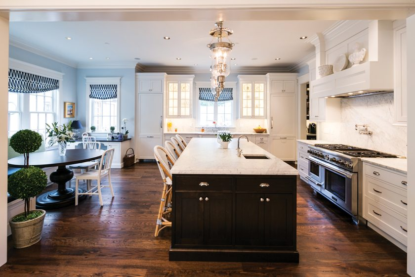 Sandy Spring Builders, LLC, crafted a transitional home with a welcoming kitchen. © MBK Photography
