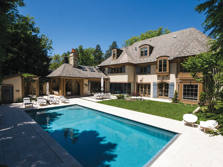 A renovation by Sandy Spring Builders, LLC, features a matching pool house. © MBK Photography