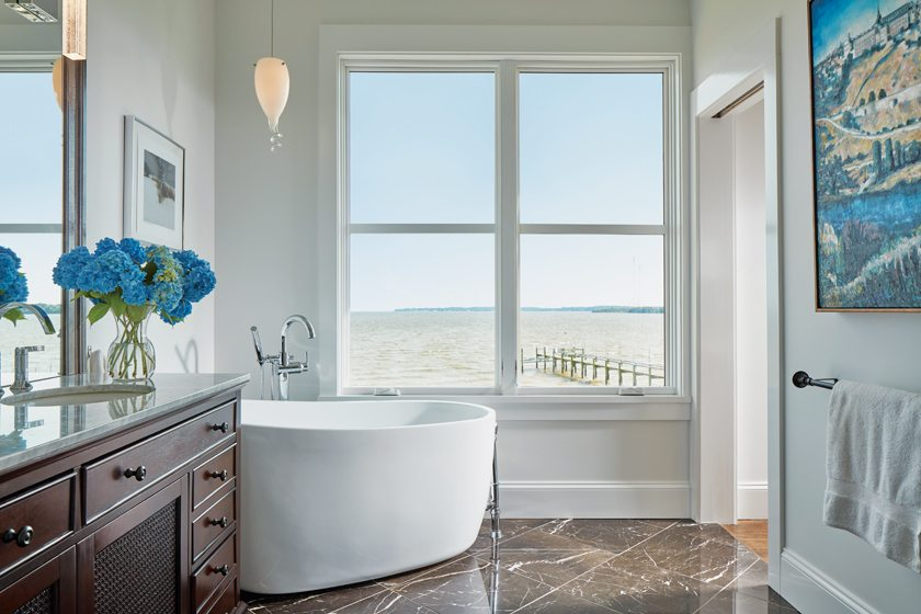 The luxurious master bath combines St. Laurent marble tile floors and a soaking tub from Signature Hardware.