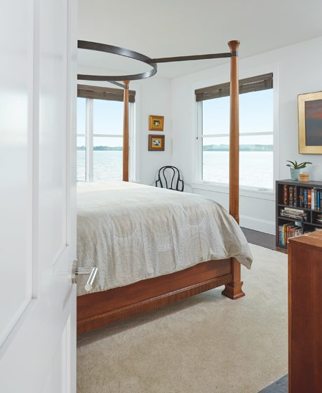 The second-floor master bedroom boasts water views in  two directions.