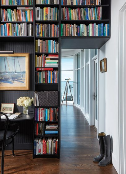 Hansen's home office features a desk built into the bookshelf.