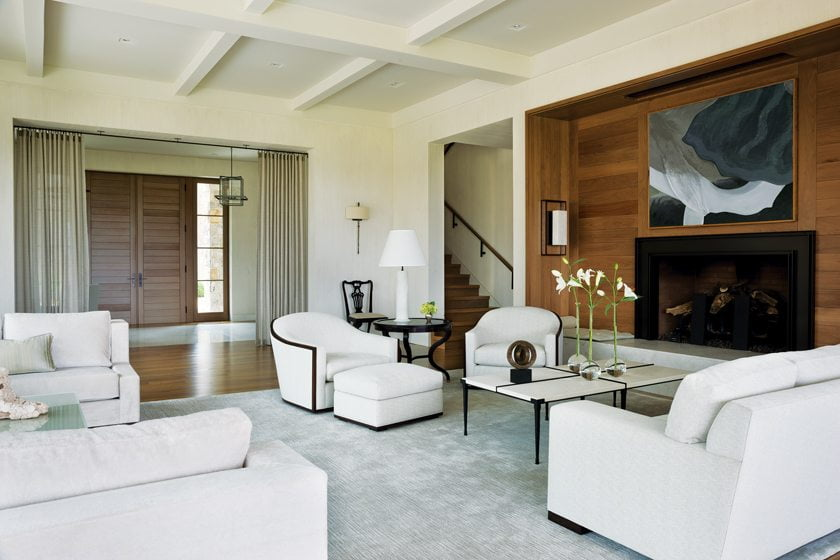 Near the entry, a pair of Michael Berman swivel chairs graces the living room.