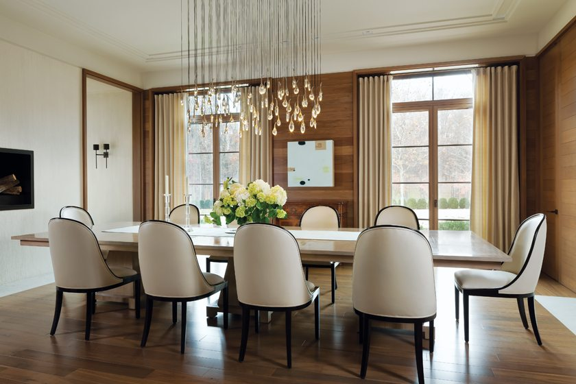 In the dining room, the sculptural Seed Cloud chandelier by Ochre adds a dose of glamour.