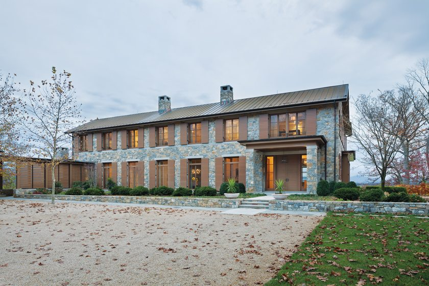 The home's limestone exterior features African sapele windows and shutters from Tradewood.