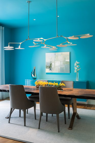 A Lindsey Adelman chandelier hangs like a sculpture above the custom walnut BDDW table in the dining room.