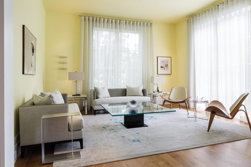 Low-slung Christian Liaigre sofas and Hans Wegner Shell Chairs furnish the living room.