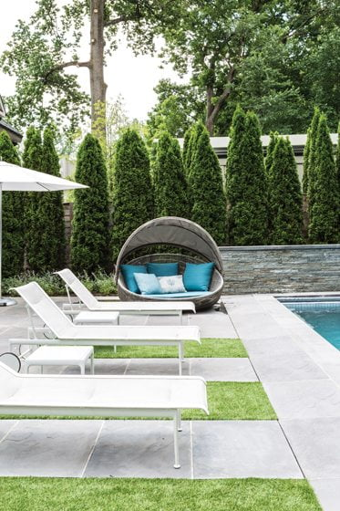 The yard is an oasis where Richard Schultz chaises and a B&B Italia Canasta sofa beckon.
