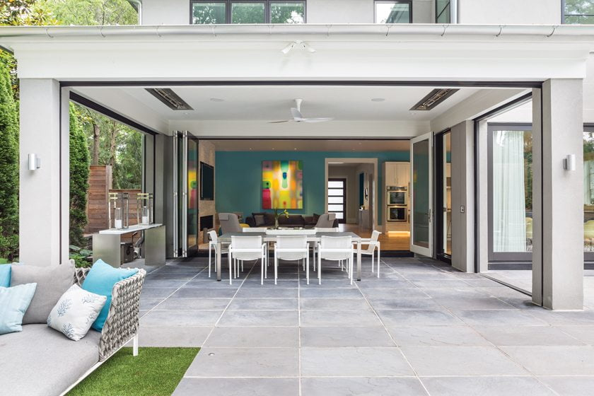Bi-fold doors by Jeld-Wen open the family room to the porch, which boasts automated screens.