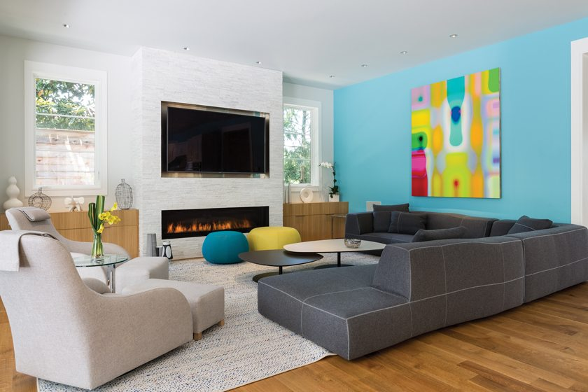A Colby Caldwell painting presides over a B&B Italia sectional in the family room.