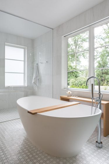 An MTI tub and an oversized shower create a Zen-like vibe in the master bath.