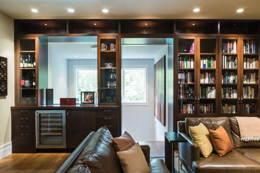 The husband's study on the top floor, with built-ins and bar, is a bastion of dark wood and leather.