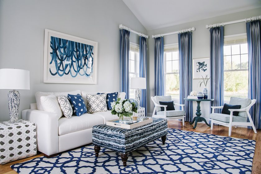 The sitting room continues the blue-and-white theme.