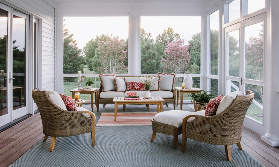 Teak-and-cane furniture from Lane Venture graces the new porch.