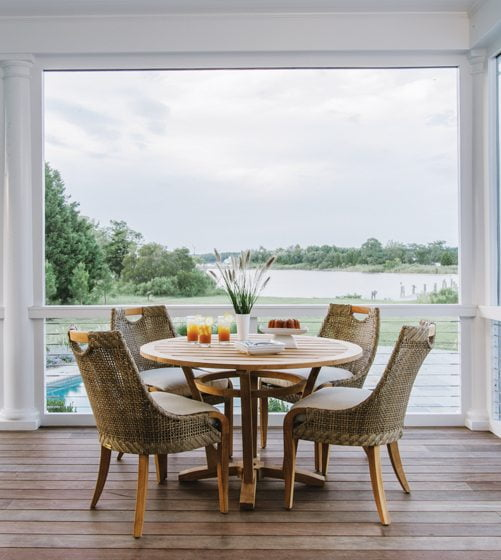 The kitchen opens to a new deck with a dining area, making entertaining a breeze.