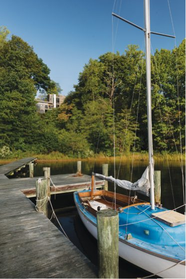 A path winds from the hilltop home to an existing dock, where the owners anchor their 1957 sailboat.