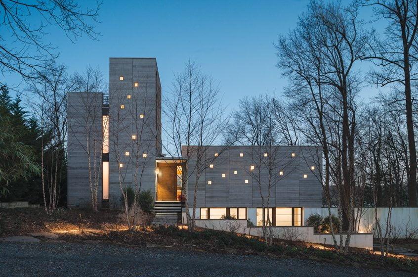 "Randomly spaced glass-block windows add ""a sense of life and activity"" to Dynerman's boxy, cedar-clad creation."