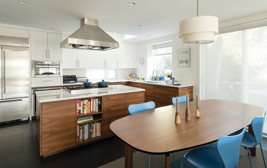 The remodeled kitchen features a Jaime Hayon-designed table from Fritz Hansen with Series 7 chairs.