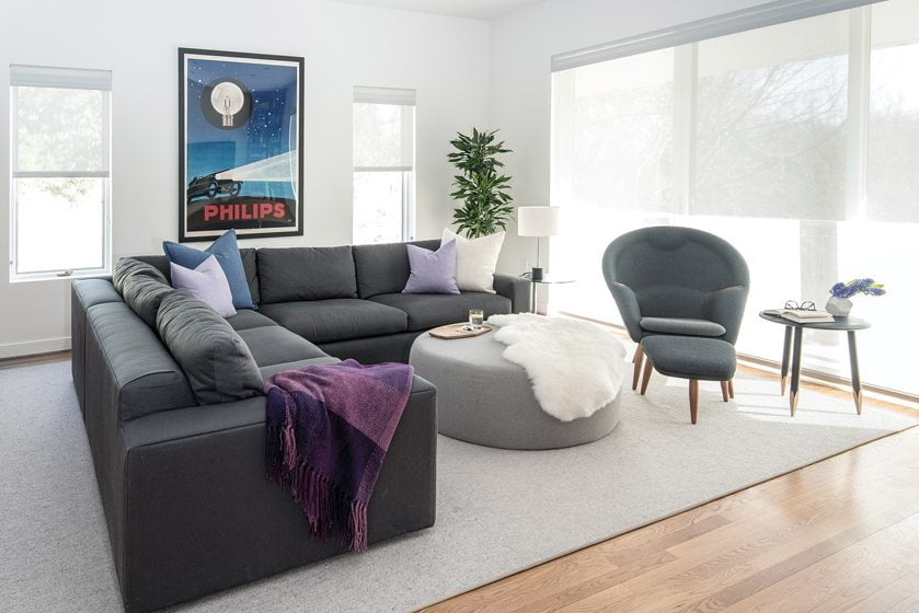 The family room combines a Room & Board sectional and ottoman with an Oda Chair and footstool.