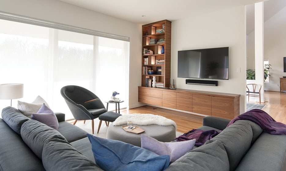 Walnut built-ins frame the TV in the family room.