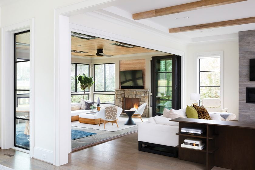Folding window panels by Jeld-Wen open to the sunroom, letting the two spaces flow together.