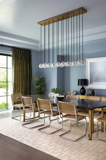 In the adjacent dining room a Restoration Hardware chandelier is a sleek focal point.
