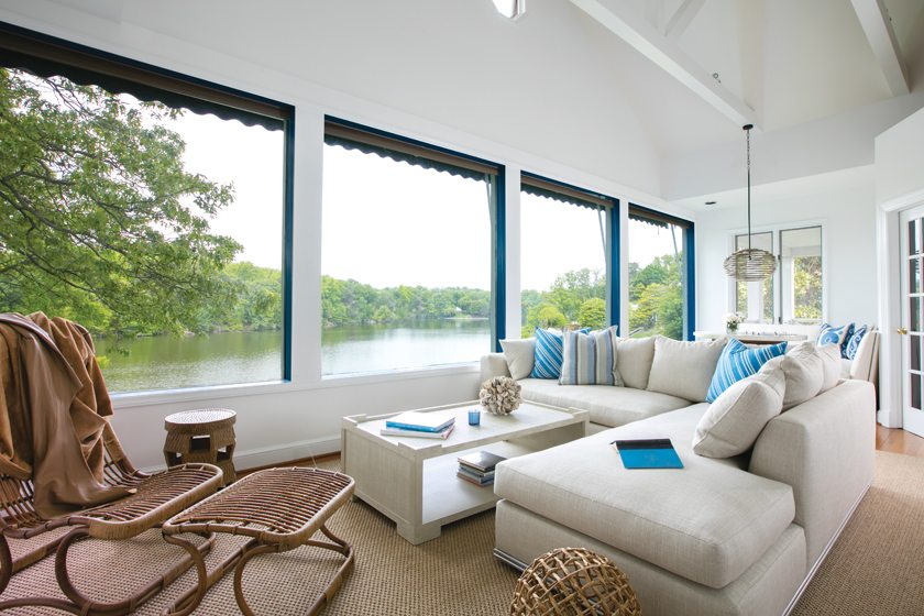 In the family room, a Nathan Anthony sectional and Palecek coffee table take in the view of Otter Pond.