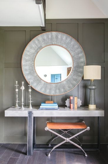 A Four Hands console table is offset by a round mirror from Made Goods.