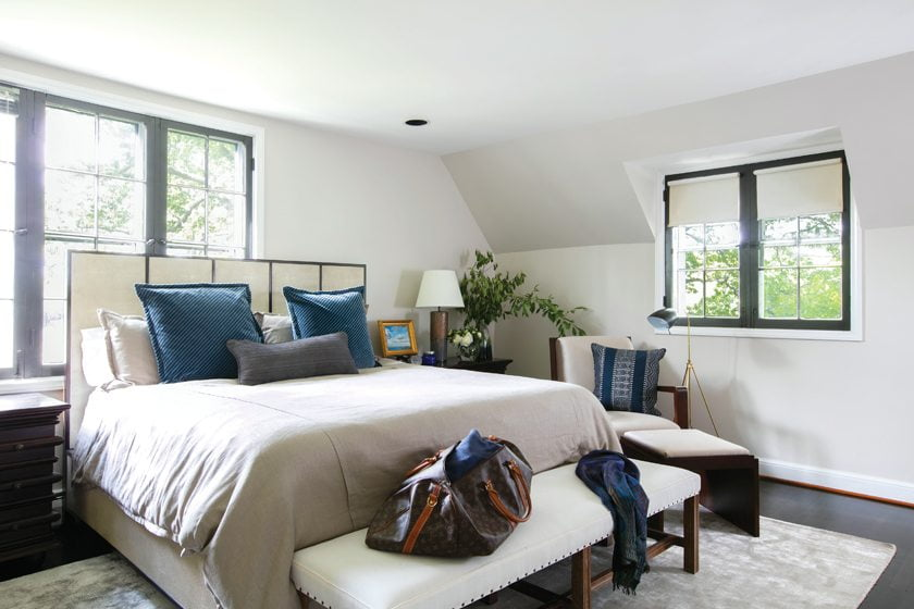 On the ground floor, the restful master bedroom features a faux-shagreen Sherrill headboard.