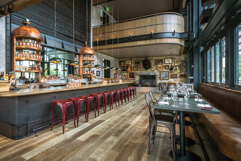 Patrick Sutton designed Baltimore's Rye Street Tavern, featuring rich leather and wood accents. © Noah Fecks