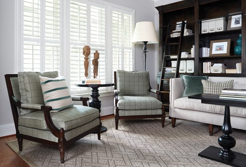 The reading room offers an alternative to a formal living room. A subtle checked fabric covers the Lillian August chairs.