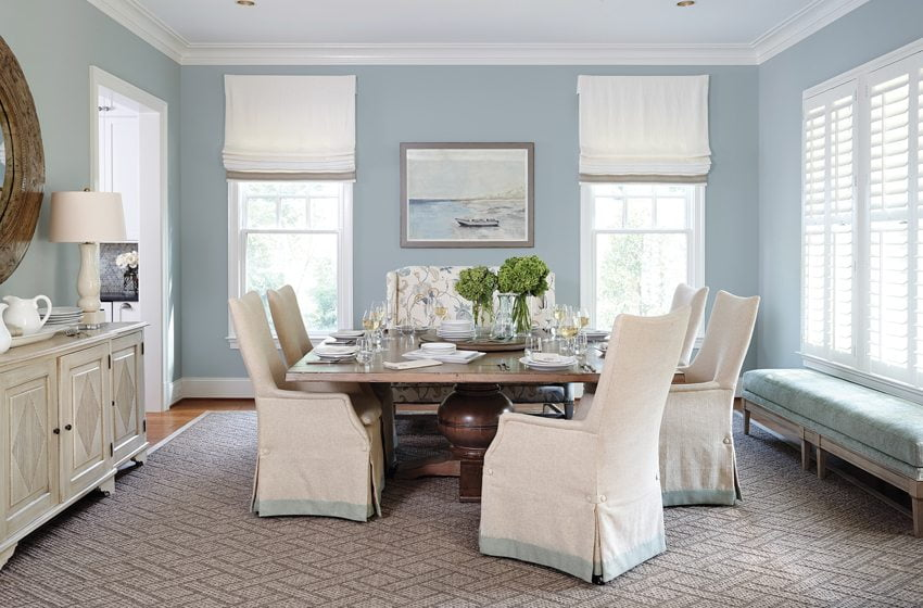 The dining room boasts a square table surrounded by Caracole chairs and a Tritter Feefer sideboard.