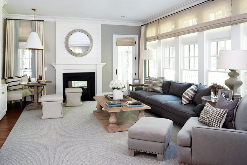 A sofa and armchairs in washable linen outfit the kid-friendly family room.