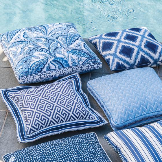 The En Vacances collection adorns throw pillows for outdoor use.