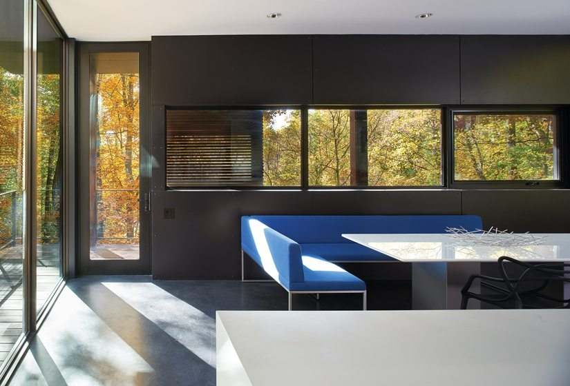 The kitchen opens out to a deck that wraps around the corner of the house.