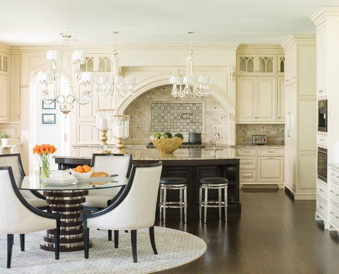 Custom kitchen cabinetry complements a mosaic backsplash created by Halewski using Conestoga Tile.