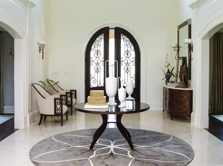 A custom rug and round table by Century create a strong focal point in the foyer.