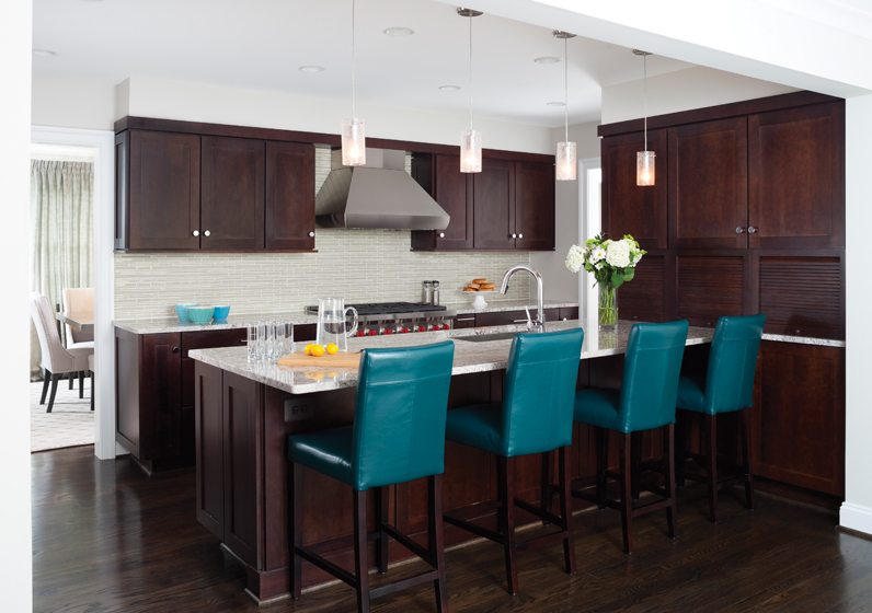 The kitchen now boasts plenty of space for the family to gather around a large island that seats four for casual meals.