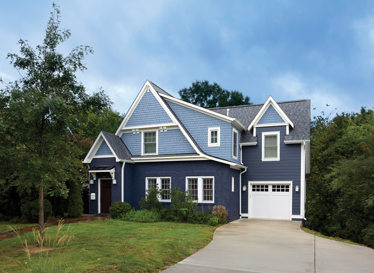 The house was remodeled with Maibec natural cedar shingles and siding, painted blue with crisp, white trim.